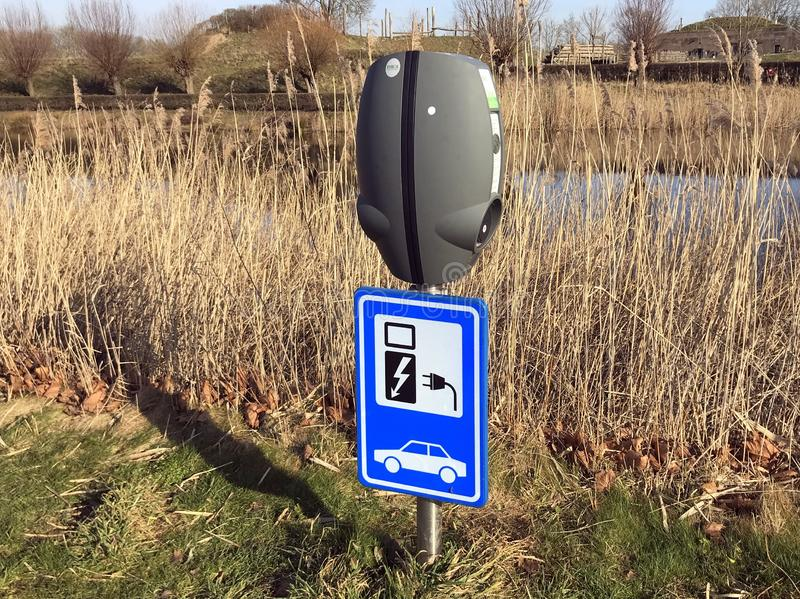 Public electric car charging station. Herwijnen, the Netherlands - February 18, 2019: Public electric car charger stations royalty free stock photo