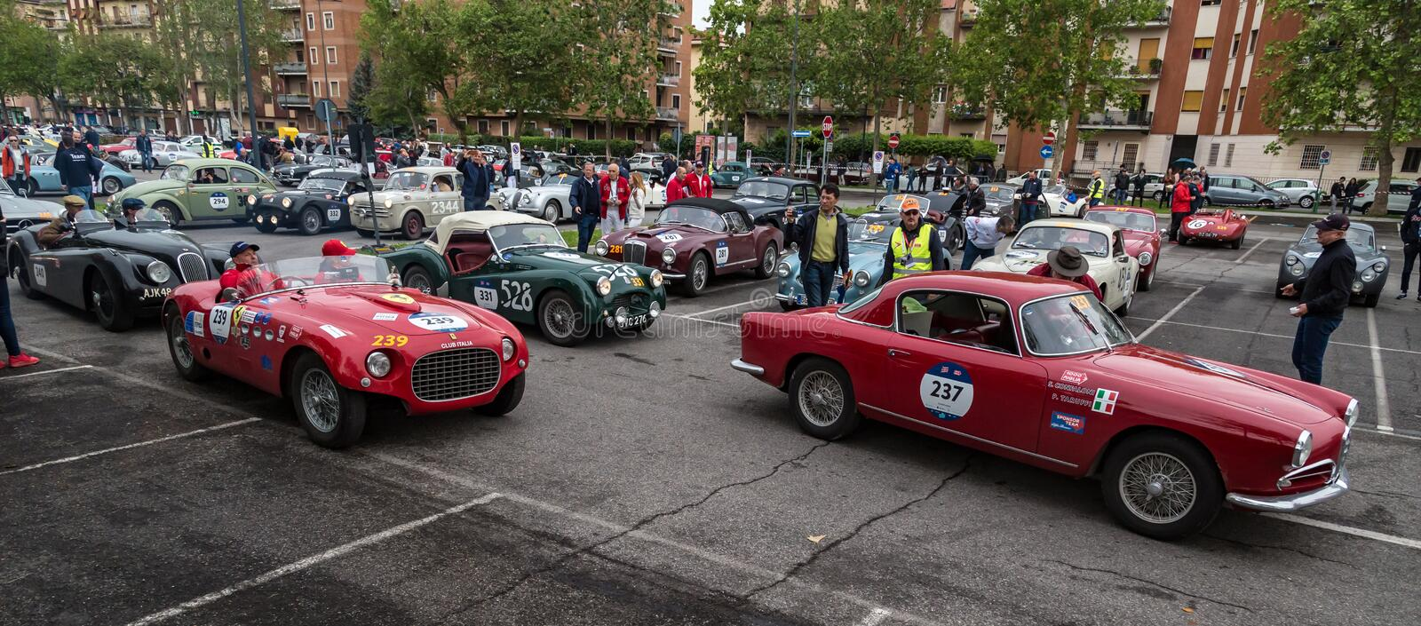 Public event of historical Parade of MilleMiglia a classic italian road race with vintage cars. Brescia, Italy - May 18, 2019: Triumphant entry of the classic royalty free stock image