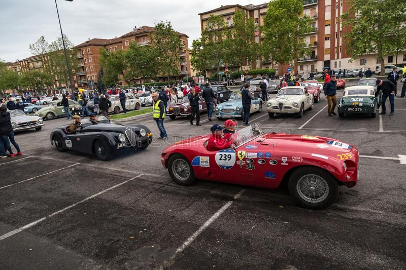 Public event of historical Parade of MilleMiglia a classic italian road race with vintage cars. Brescia, Italy - May 18, 2019: Triumphant entry of the classic royalty free stock photos