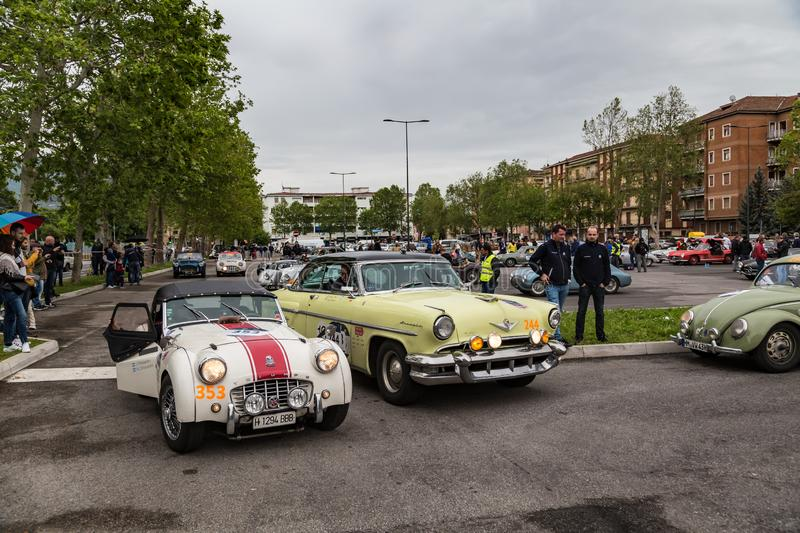 Public event of historical Parade of MilleMiglia a classic italian road race with vintage cars. Brescia, Italy - May 18, 2019: Triumphant entry of the classic stock images