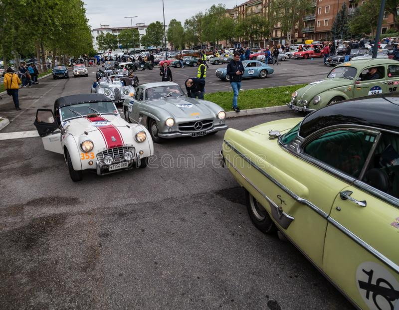 Public event of historical Parade of MilleMiglia a classic italian road race with vintage cars. Brescia, Italy - May 18, 2019: Triumphant entry of the classic royalty free stock photo