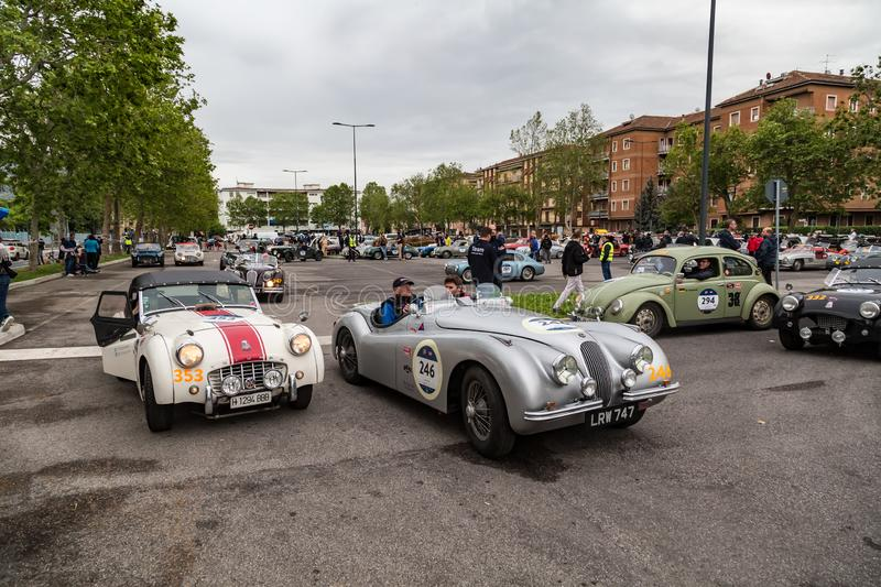 Public event of historical Parade of MilleMiglia a classic italian road race with vintage cars. Brescia, Italy - May 18, 2019: Triumphant entry of the classic royalty free stock images