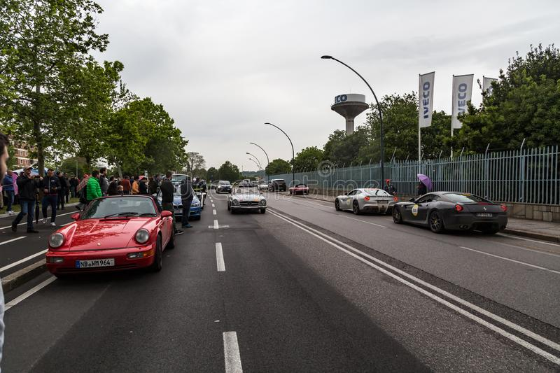 Public event of historical Parade of MilleMiglia a classic italian road race with vintage cars. Brescia, Italy - May 18, 2019: Triumphant entry of the classic stock image
