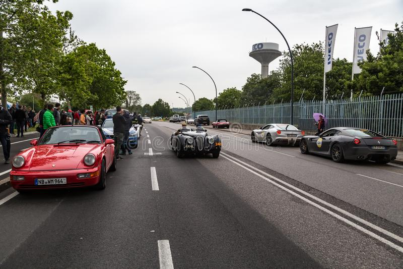 Public event of historical Parade of MilleMiglia a classic italian road race with vintage cars. Brescia, Italy - May 18, 2019: Triumphant entry of the classic royalty free stock photography