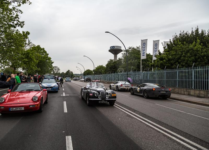 Public event of historical Parade of MilleMiglia a classic italian road race with vintage cars. Brescia, Italy - May 18, 2019: Triumphant entry of the classic stock photography