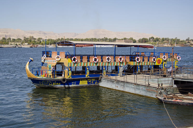 Public Ferry, River Nile, Luxor. LUXOR, EGYPT - FEBRUARY 9, 2017: Crew resting at the pontoon for the public ferry which crosses the River Nile between Luxor and royalty free stock photo