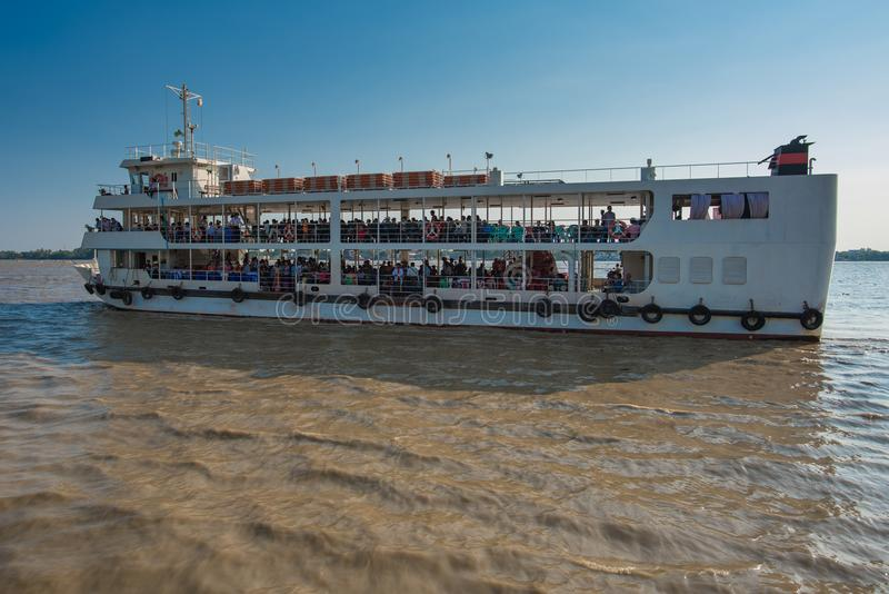 Public ferry to crossing Yangon river. Yangon, Myanmar - December 28, 2016: Public transportation to crossing Yangon river by large ferry in greater Yangon royalty free stock photo