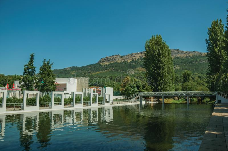 Public fluvial pool on the Sever River in Portagem. View of public fluvial pool on the Sever River in a sunny day and Marvao village on top of crag, seen from royalty free stock photography