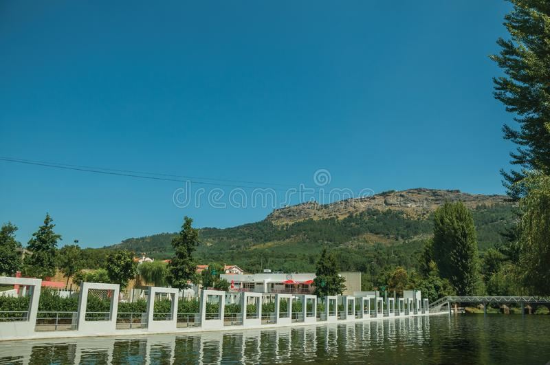 Public fluvial pool on the Sever River in Portagem. View of public fluvial pool on the Sever River in a sunny day and Marvao village on top of crag, seen from royalty free stock image