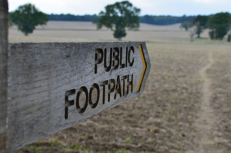 Public footpath direction sign. stock images