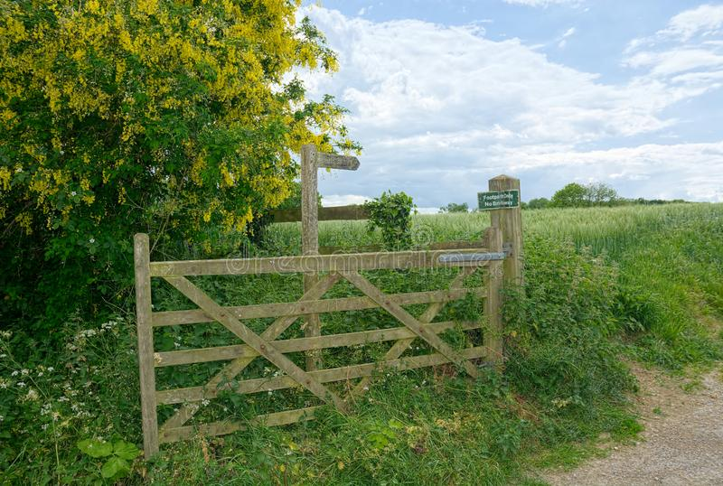Public footpath sign. Wooden gate. royalty free stock images