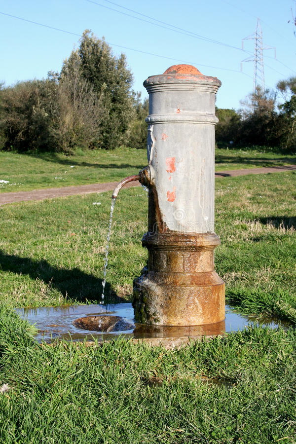 Public fountain for free drinking water in Italy royalty free stock photo