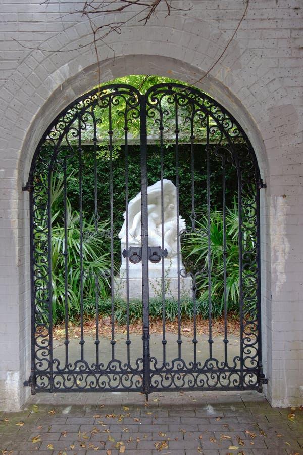 Public garden entrance (black wrought iron gate) stock images