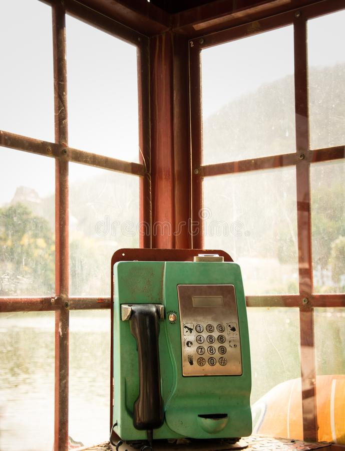 Public green telephone. The public green telephone in box stock photography