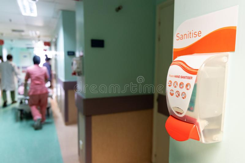 Public hand disinfectant sanitizer dispenser available in hospital for hygiene royalty free stock photography