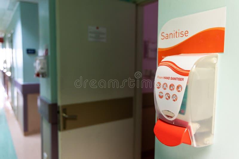 Public hand disinfectant sanitizer dispenser available in hospital for hygiene stock images