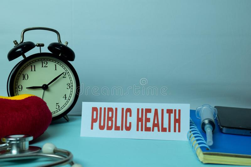 Public Health Planning on Background of Working Table with Office Supplies royalty free stock photos