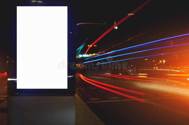 public information board in night city with the movement cars on background, clear advertising mock outdoors royalty free stock images