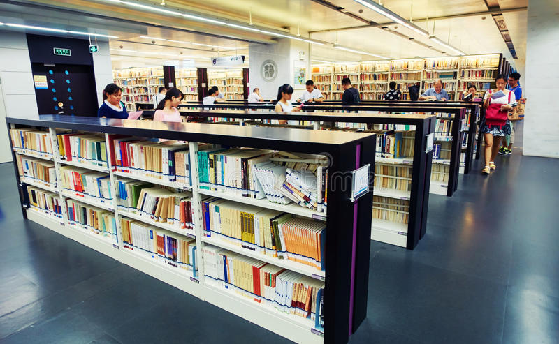 Library. Interior of Guangzhou library in Guangzhou, China. Readers, books and bookshelf in public library royalty free stock photography