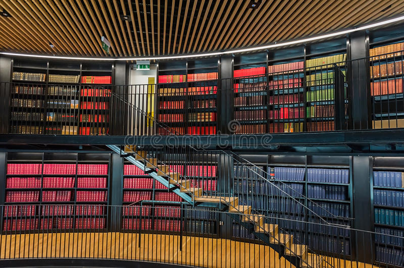 Public library. Interior of a public library with hundreds of books on shelves stock photography