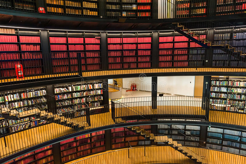Public library. Interior of a public library with hundreds of books on shelves stock image