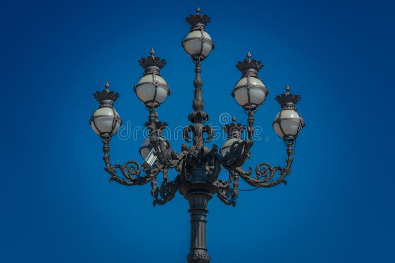 The public lighting of St. Peter`s Square in the Vatican. View of a tall street light at Saint Peter`s Square, Vatican City stock photography