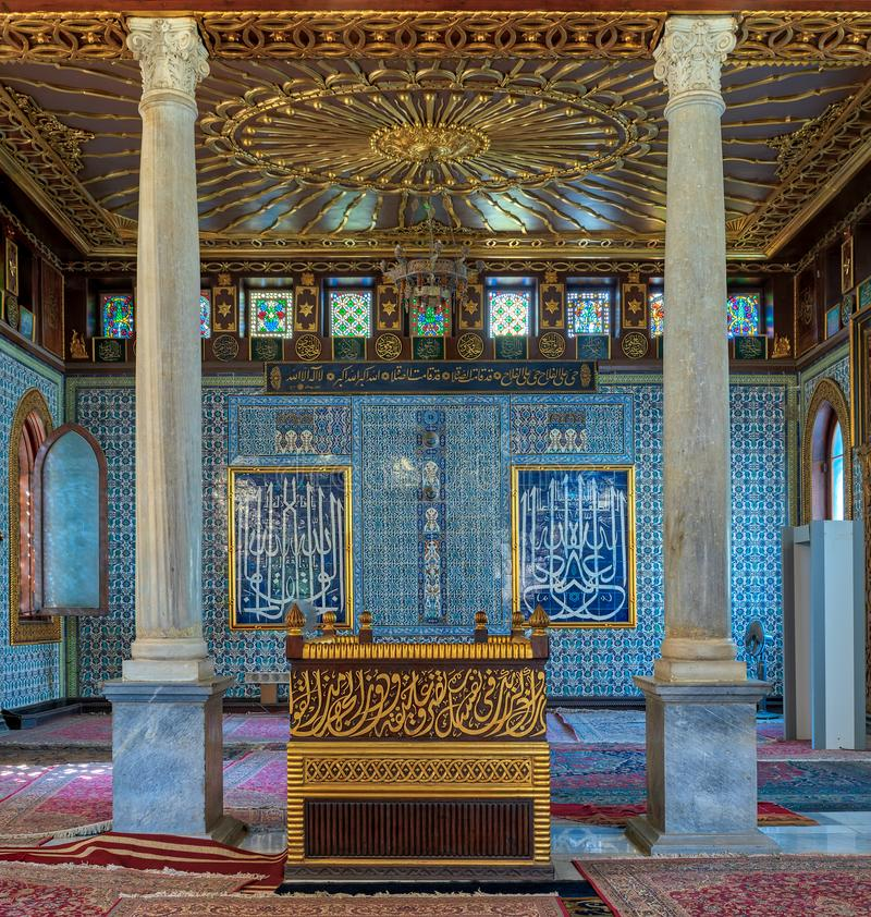 Public mosque of Manial Palace of Prince Mohammed Ali Tewfik with wooden golden ornate ceilings, Cairo, Egypt. Interior of public mosque of Manial Palace of stock photos