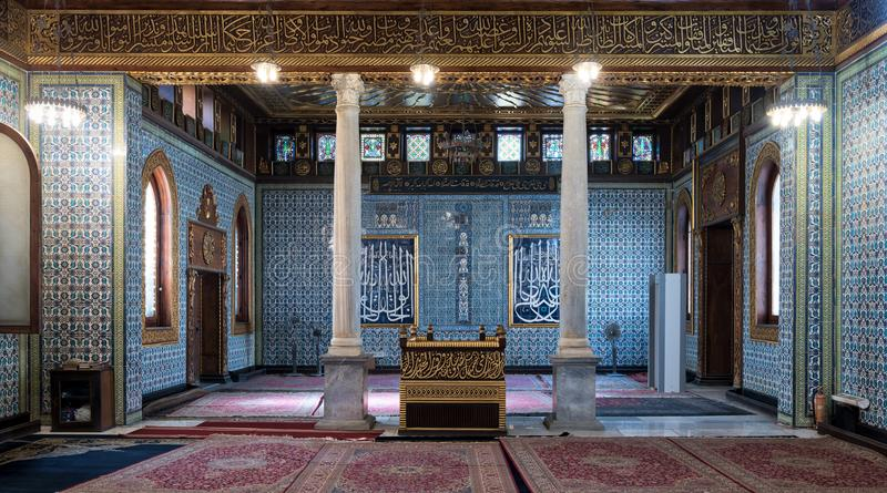 Public mosque of Manial Palace of Prince Mohammed Ali with wooden golden ornate ceilings, Cairo, Egypt. Cairo, Egypt - December 2, 2017: Interior of public royalty free stock photography