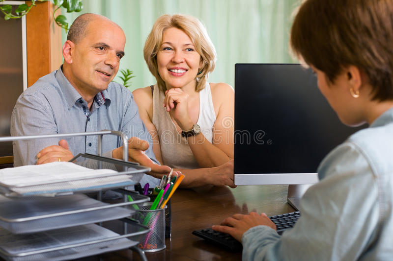 Public notary helping happy aged couple to make a will royalty free stock image