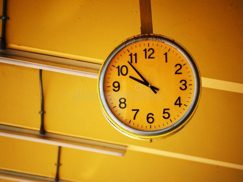 Public old clock. In a railway station royalty free stock photo