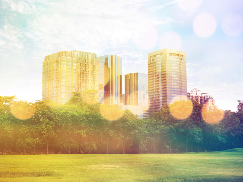 Public park in the city and high building, vintage filter effect.  royalty free stock photos