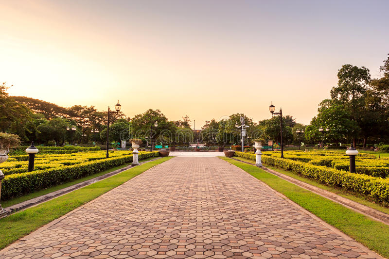 Public park. Or landscape with footpath on sunset stock image