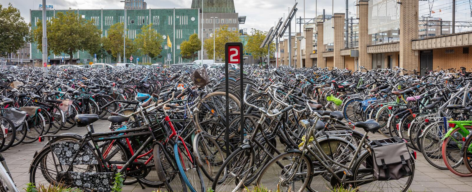 Public parking lot for bicycles background in Eindhoven, Netherlands stock image