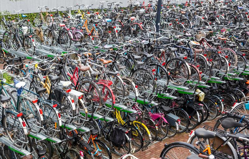 Public parking lot for bicycles in Rotterdam, background. Colorful bicycles in a public two-storey parking station, in the city center of Rotterdam, background royalty free stock images