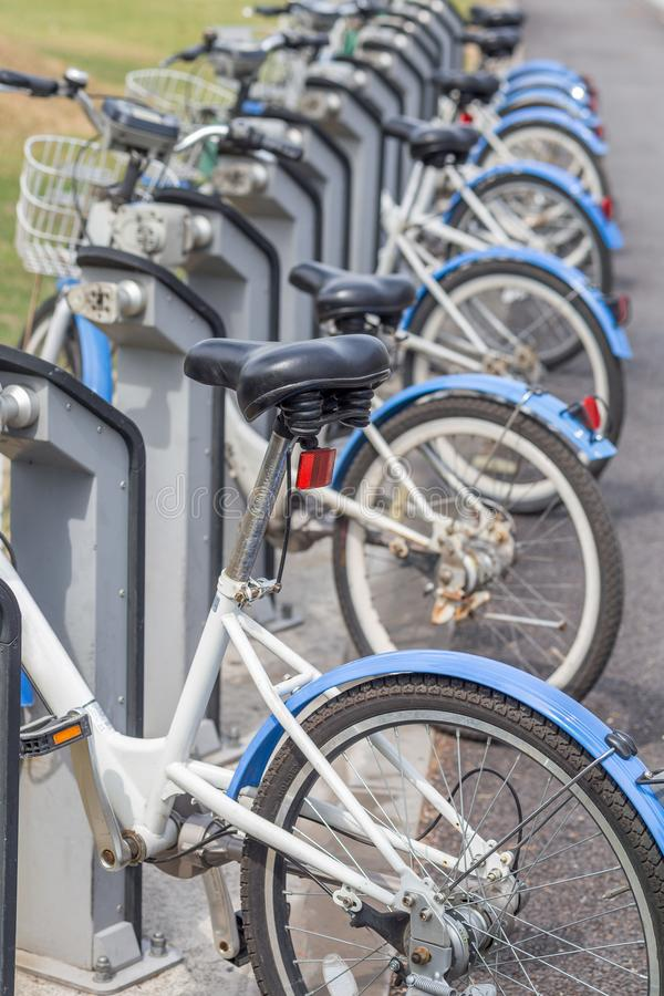 Public parking for rental bicycles in South Korea, Daejeon, vert. Ical, closeup stock photography
