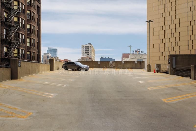 Public parking on the roof on the Chicago background, Illinois, USA. Public parking on the roof on the Chicago background, Illinois royalty free stock images