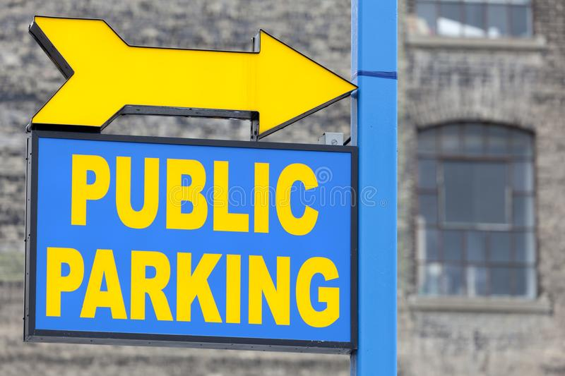 Public parking sign. Blue and yellow public parking sign royalty free stock image