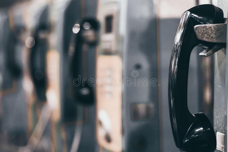 The public pay phone close up, phone and headset. In public place blur background stock photography