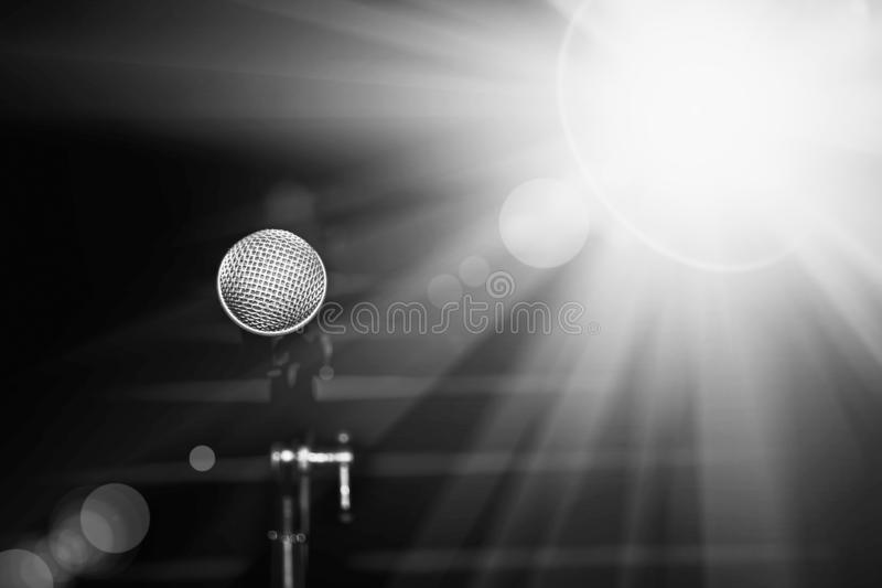 Public performance on stage. Microphone on abstract blurred of speech in seminar room or speaking conference hall stock photography