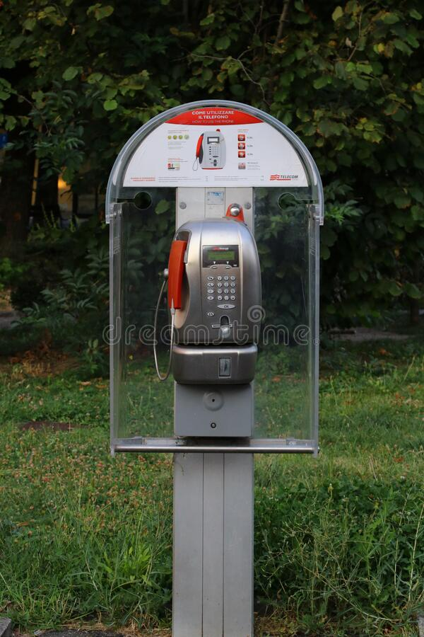Public phone in the italian city stock images