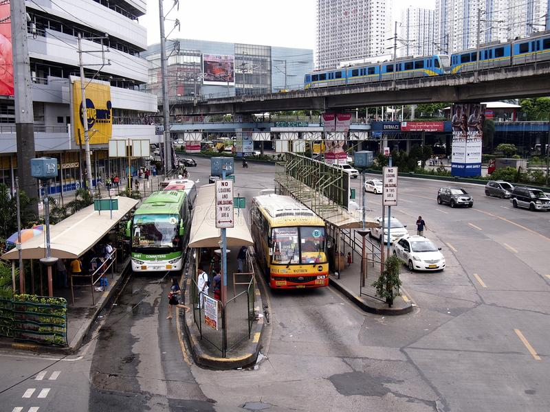 Public and private transportation vehicles along EDSA royalty free stock image
