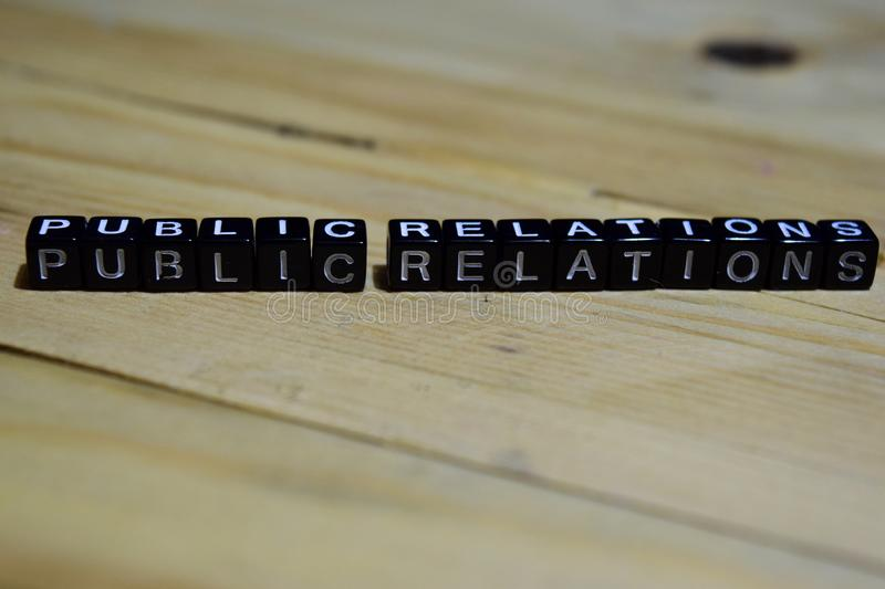 Public relations message written on wooden blocks. royalty free stock photos