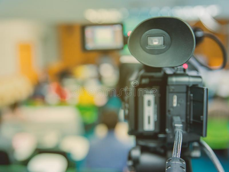 Public relations - PR. Filming an media event with a video camera royalty free stock image