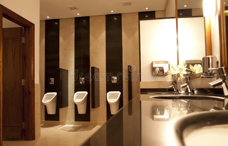 Public restroom. Perspective shot of a public restroom stock photo