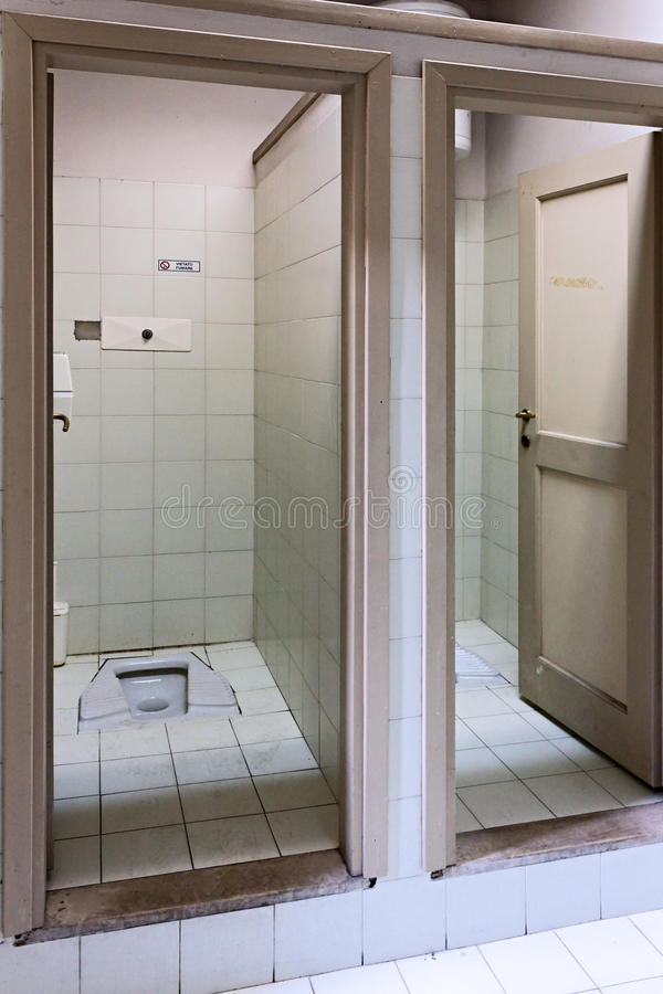 Squat toilet. Public restroom with squat toilet stock photo