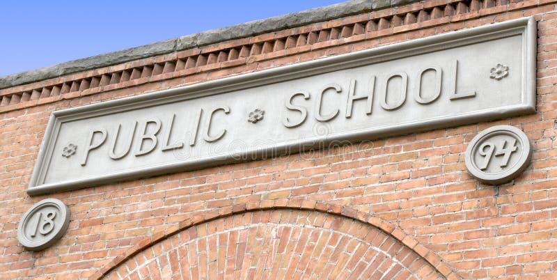 Public School Sign on Brick Building. Old Public School Sign Plaque on a Brick Building stock image