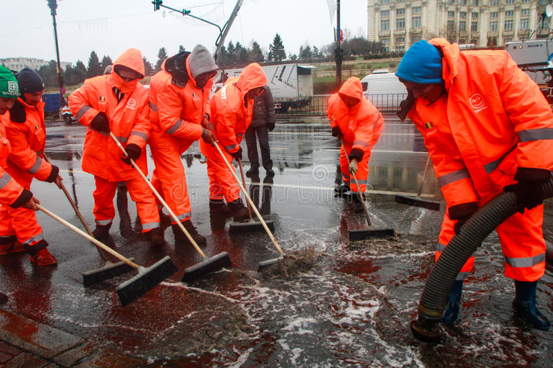 Public service workers. BUCHAREST, ROMANIA, DECEMBER 1, 2014: Public service workers are working on sewage after heavy precipitations in Bucharest stock photos