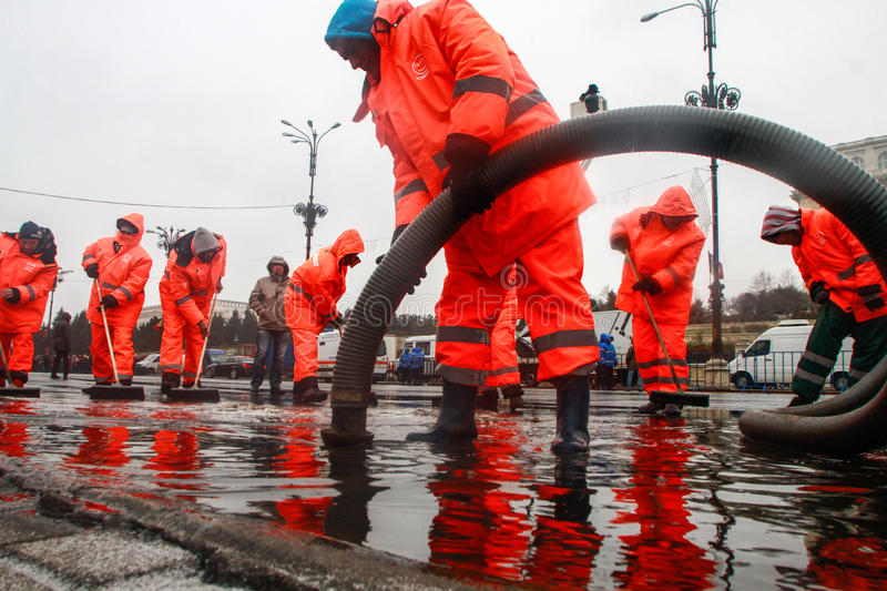 Public service workers. BUCHAREST, ROMANIA, DECEMBER 1, 2014: Public service workers are working on sewage after heavy precipitations in Bucharest royalty free stock photos