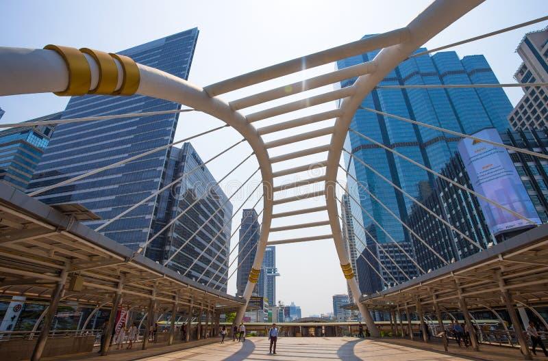 Public sky-walk at sky-train station `Chong Nonsi` in Bangkok downtown square, Bangkok, Thailand. stock photography