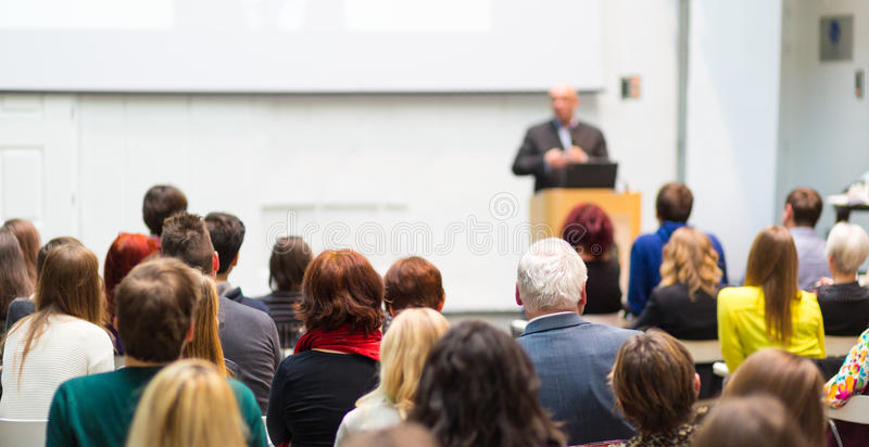 Public speaker giving talk at Business Event. royalty free stock images